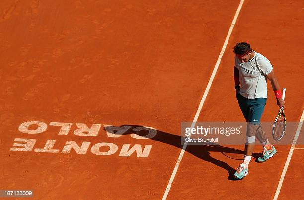 Rafael Nadal of Spain shows his dejection during his straight set defeat against Novak Djokovic of Serbia in their final match during day eight of...