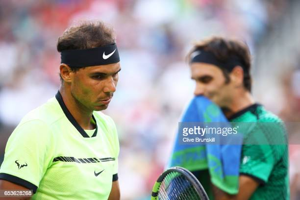 Rafael Nadal of Spain shows his dejection during his straight sets defeat by Roger Federer of Switzerland in their fourth round match during day ten...