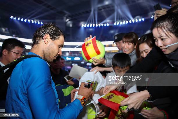 Rafael Nadal of Spain sign to the fans after winning the Men's Singles final against Nick Kyrgios of Australia on day nine of the 2017 China Open at...