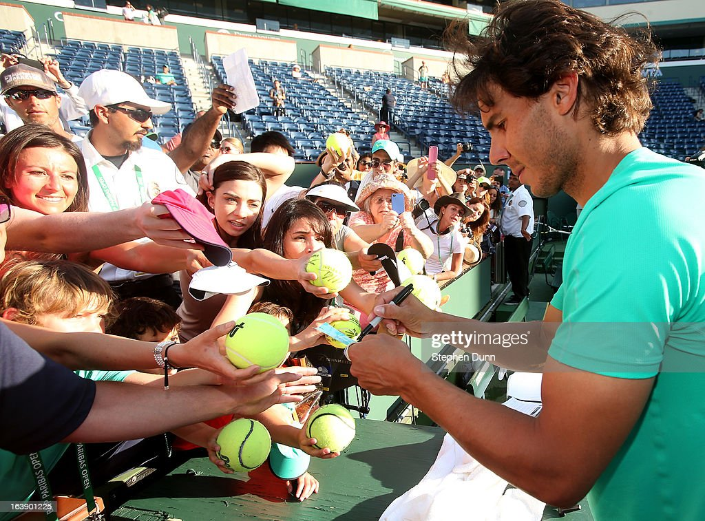 Rafael Nadal of Spain signs autographs after defeating Juan Martin Del Potro of Argentina to win the men's final match of the 2013 BNP Paribas Open at the Indian Wells Tennis Garden on March 17, 2013 in Indian Wells, California.
