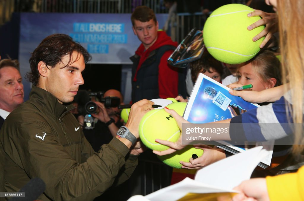 Rafael Nadal of Spain signs autographs after his men's singles semi-final match against Roger Federer of Switzerland during day seven of the Barclays ATP World Tour Finals at O2 Arena on November 10, 2013 in London, England.