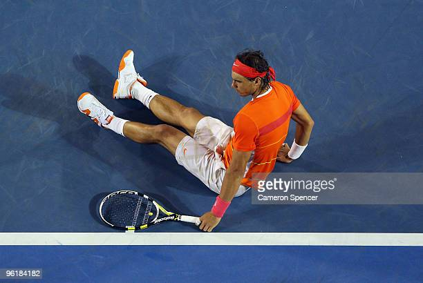 Rafael Nadal of Spain sits on the court after falling over in his quarterfinal match against Andy Murray of Great Britain during day nine of the 2010...
