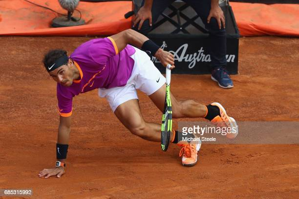 Rafael Nadal of Spain slips during the men's quarterfinal match against Dominic Thiem of Austria on Day Six of the Internazionali BNL d'Italia 2017...