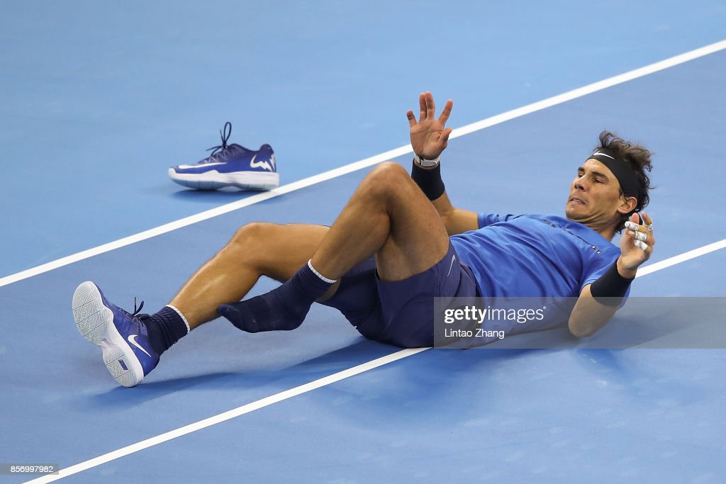 Rafael Nadal of Spain slips fall during against Lucas Pouille of France in the Men's singles first round on day four of 2017 China Open at the China National Tennis Centre on October 3, 2017 in Beijing, China.
