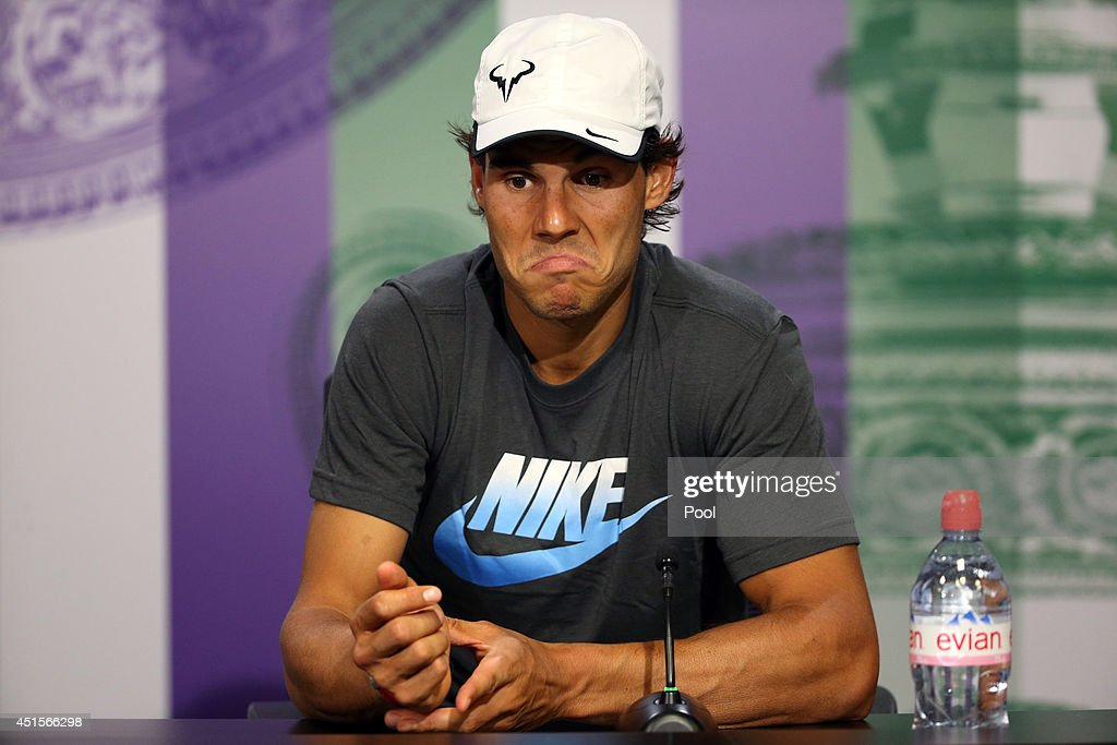 <a gi-track='captionPersonalityLinkClicked' href=/galleries/search?phrase=Rafael+Nadal&family=editorial&specificpeople=194996 ng-click='$event.stopPropagation()'>Rafael Nadal</a> of Spain speaks during a press conference after losing his Gentlemen's Singles fourth round match against Nick Kyrgios of Australia on day eight of the Wimbledon Lawn Tennis Championships at the All England Lawn Tennis and Croquet Club on July 1, 2014 in London, England.