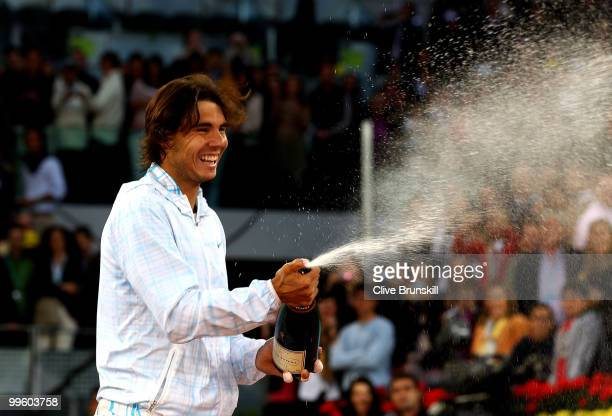 Rafael Nadal of Spain sprays champagne after his straight sets victory against Roger Federer of Switzerland in the mens final match during the Mutua...