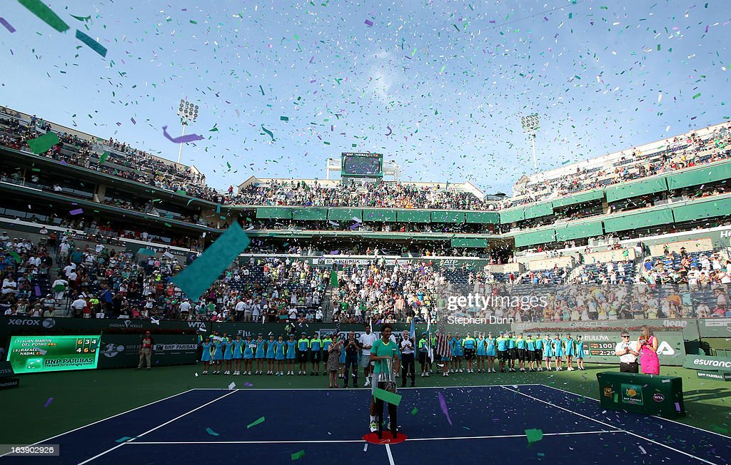 Rafael Nadal of Spain stands by the tropy as confetti flies after defeating Juan Martin Del Potro of Argentina to win the men's final match of the 2013 BNP Paribas Open at the Indian Wells Tennis Garden on March 17, 2013 in Indian Wells, California.