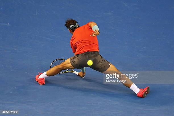 Rafael Nadal of Spain stretches for a shot in his men's final match against Stanislas Wawrinka of Switzerland during day 14 of the 2014 Australian...