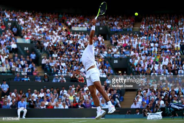 Rafael Nadal of Spain stretches for the ball during the Gentlemen's Singles fourth round match against Gilles Muller of Luxembourg on day seven of...