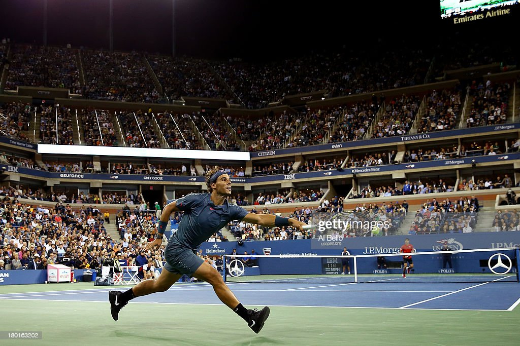 Rafael Nadal of Spain stretches to play a backhand during his men's singles final match against Novak Djokovic of Serbia on Day Fifteen of the 2013 US Open at the USTA Billie Jean King National Tennis Center on September 9, 2013 in the Flushing neighborhood of the Queens borough of New York City.