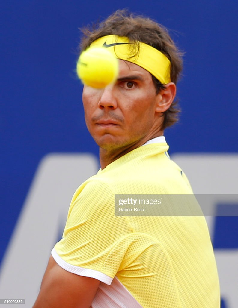 <a gi-track='captionPersonalityLinkClicked' href=/galleries/search?phrase=Rafael+Nadal&family=editorial&specificpeople=194996 ng-click='$event.stopPropagation()'>Rafael Nadal</a> of Spain takes a backhand shot during a match between <a gi-track='captionPersonalityLinkClicked' href=/galleries/search?phrase=Rafael+Nadal&family=editorial&specificpeople=194996 ng-click='$event.stopPropagation()'>Rafael Nadal</a> of Spain and Dominic Thiem of Austria as part of ATP Argentina Open at Buenos Aires Lawn Tennis Club on February 13, 2016 in Buenos Aires, Argentina.