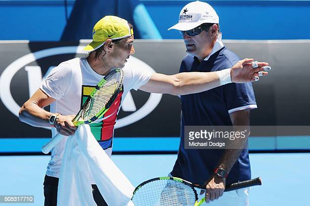 Rafael Nadal of Spain talks with coach Toni Nadal during a practice session ahead of the 2016 Australian Open at Melbourne Park on January 17 2016 in...