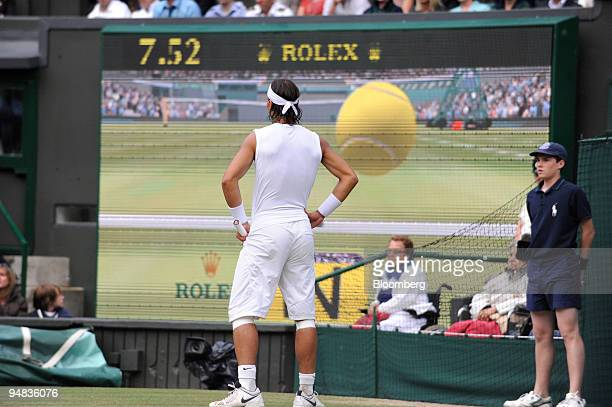 Rafael Nadal of Spain the men's number two seed watches the verdict of an appeal to HawkEye the highspeed multicamera technology used to adjudicate a...