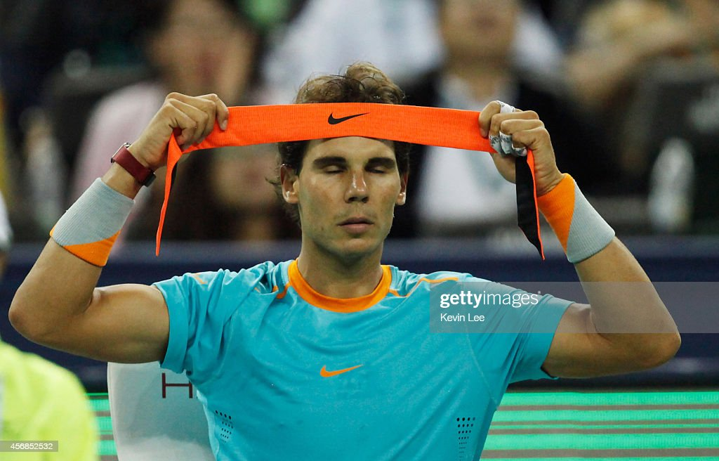 <a gi-track='captionPersonalityLinkClicked' href=/galleries/search?phrase=Rafael+Nadal&family=editorial&specificpeople=194996 ng-click='$event.stopPropagation()'>Rafael Nadal</a> of Spain tie his hand band during his match against during day 4 of the Shanghai Rolex Masters at Zi Zhong stadium on October 8, 2014 in Shanghai, China.