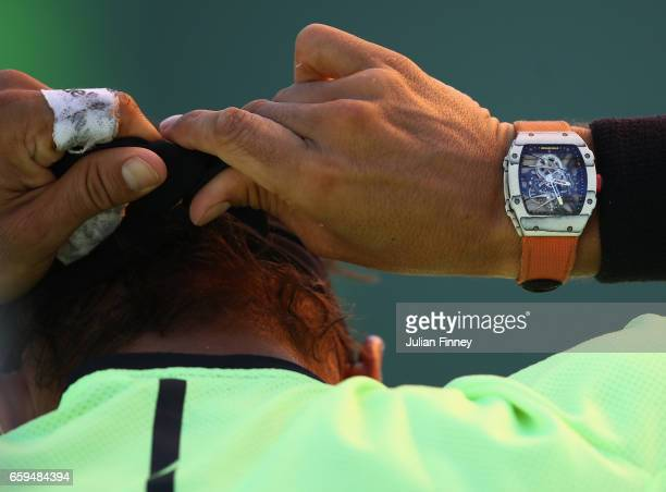 Rafael Nadal of Spain ties his bandana in his match against Nicolas Mahut of France at Crandon Park Tennis Center on March 28 2017 in Key Biscayne...