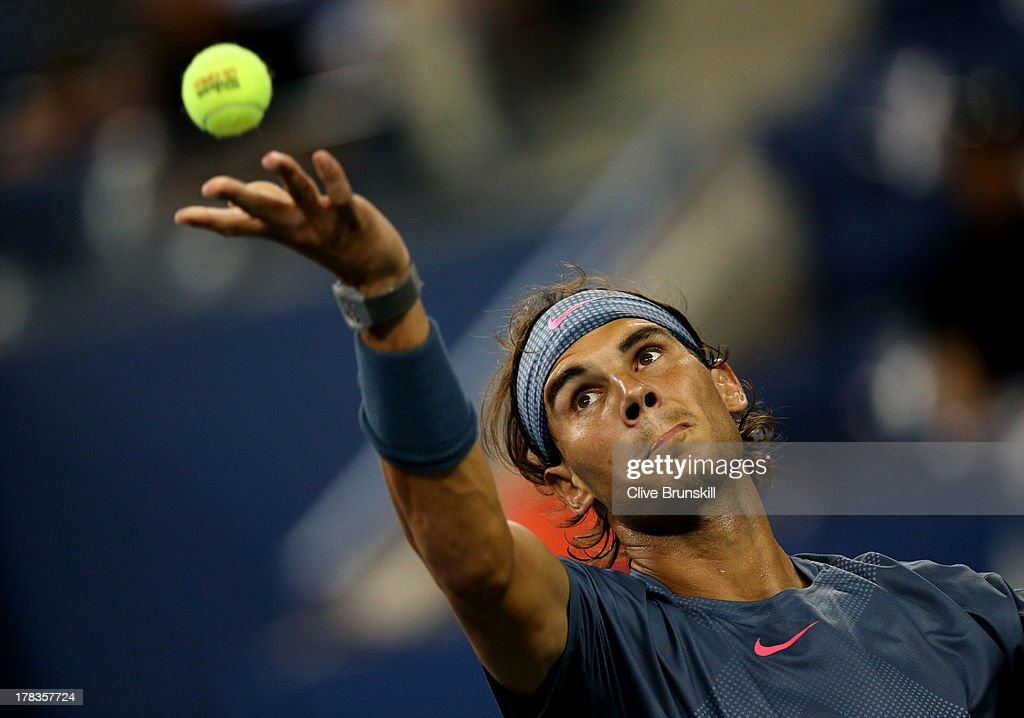 Rafael Nadal of Spain tosses the ball in the air to serve during his men's singles second round match against Rogerio Dutra Silva of Brazil on Day Four of the 2013 US Open at USTA Billie Jean King National Tennis Center on August 29, 2013 in the Flushing neighborhood of the Queens borough of New York City.