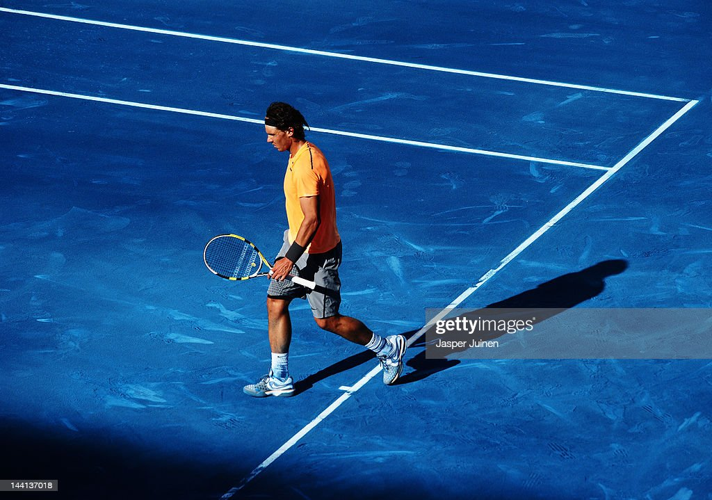 Rafael Nadal of Spain trudges off the pitch after losing his fourth round match against his fellow countryman Fernando Verdasco during the Mutua Madrilena Madrid Open tennis tournament at the Caja Magica on May 10, 2012 in Madrid, Spain.