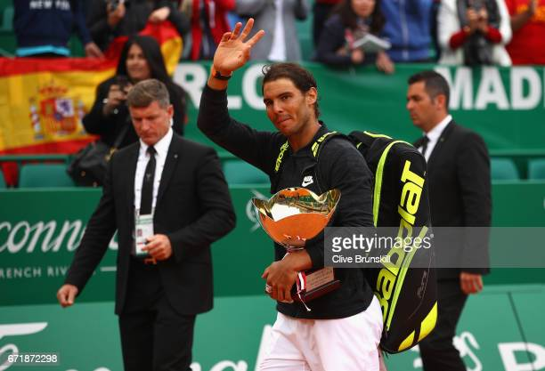 Rafael Nadal of Spain walks off court with his winners trophy after his straight set victory against Albert RamosVinolas of Spain in the final on day...