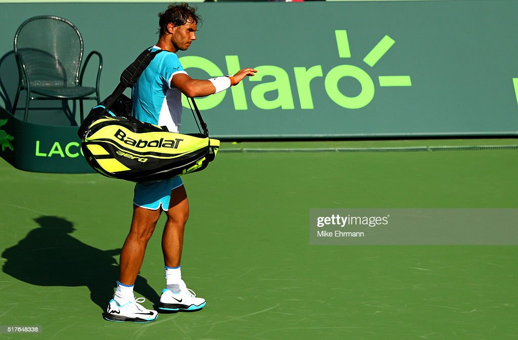 Rafael Nadal of Spain walks off the court after retiring during a match against Damir Dzumhur of Bosnia and Herzegovina during Day 6 of the Miami...