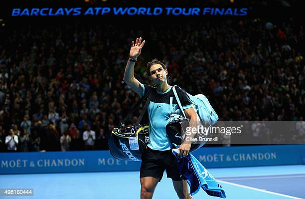 Rafael Nadal of Spain waves goodbye to the crowd after his straight sets defeat by Novak Djokovic of Serbia during the men's singles semi final match...