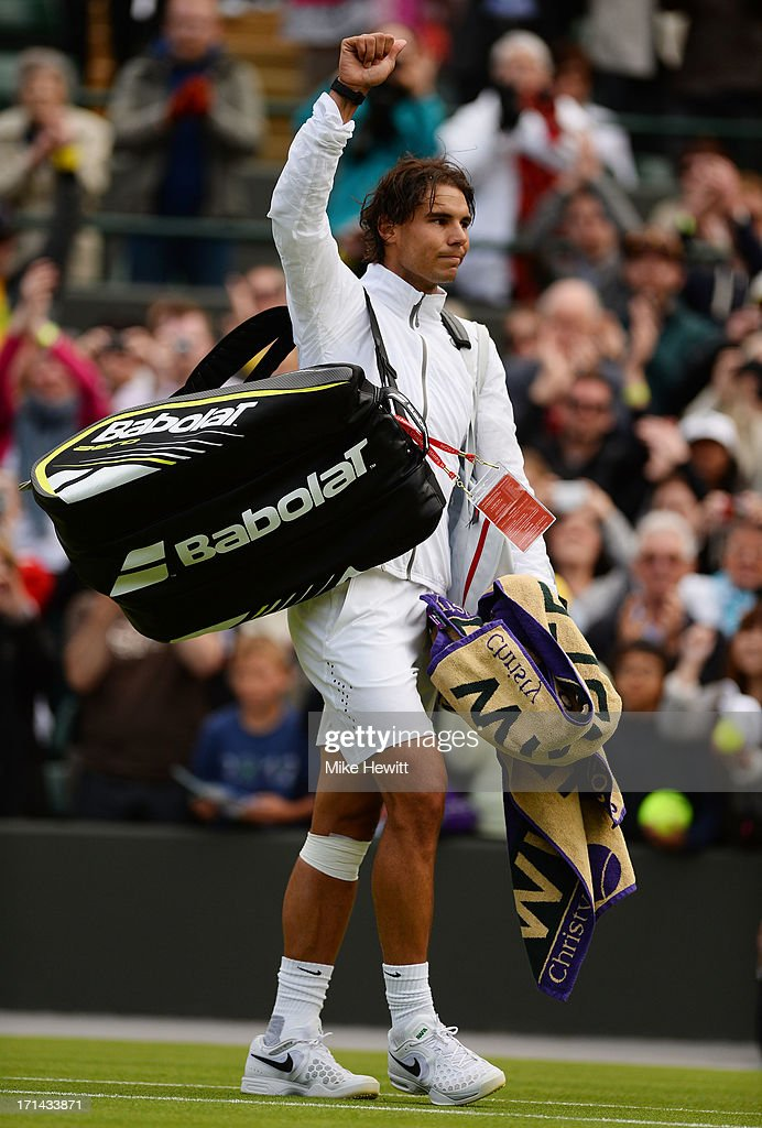 <a gi-track='captionPersonalityLinkClicked' href=/galleries/search?phrase=Rafael+Nadal&family=editorial&specificpeople=194996 ng-click='$event.stopPropagation()'>Rafael Nadal</a> of Spain waves to the crowd as he leaves Court One following his defeat to Steve Darcis of Belgium after Gentlemen's Singles first round match on day one of the Wimbledon Lawn Tennis Championships at the All England Lawn Tennis and Croquet Club on June 24, 2013 in London, England.