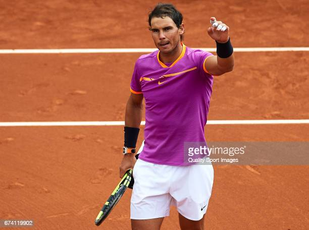 Rafael Nadal of Spain waves to the fans at his match against Kevin Anderson of South Africa during the Day 4 of the Barcelona Open Banc Sabadell at...
