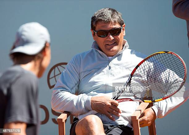 Rafael Nadal of Spain with coach and uncle Toni together in a practice session during day one of the Mutua Madrid Open tennis tournament at the Caja...