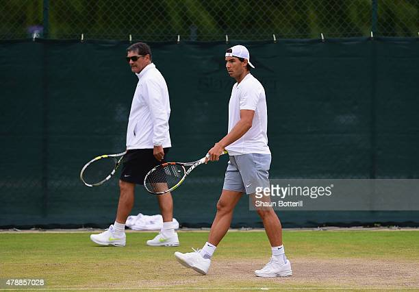 Rafael Nadal of Spain with coach Toni Nadal during a pratice session prior to the Wimbledon Lawn Tennis Championships at the All England Lawn Tennis...