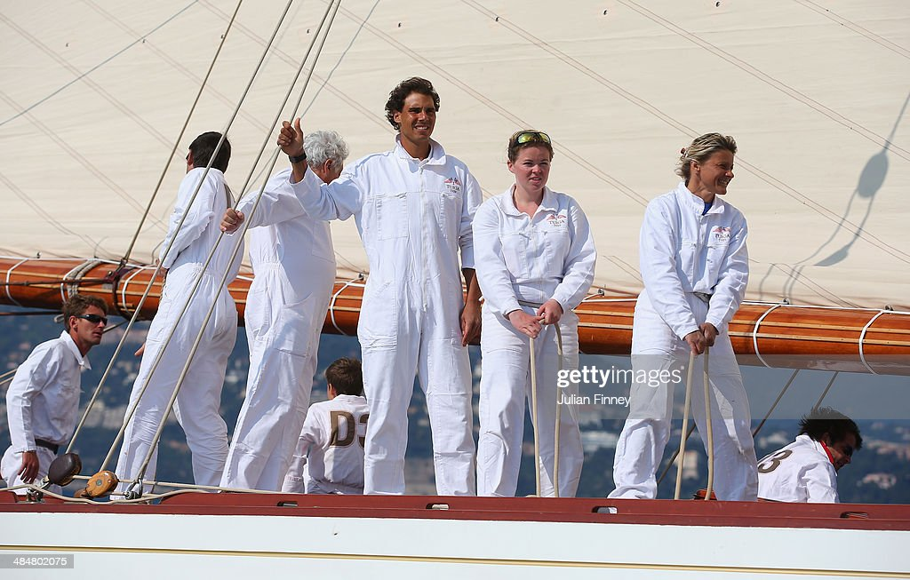 <a gi-track='captionPersonalityLinkClicked' href=/galleries/search?phrase=Rafael+Nadal&family=editorial&specificpeople=194996 ng-click='$event.stopPropagation()'>Rafael Nadal</a> of Spain with the crew as he help sail a boat during day two of the ATP Monte Carlo Rolex Masters Tennis at Monte-Carlo Sporting Club on April 14, 2014 in Monte-Carlo, Monaco.