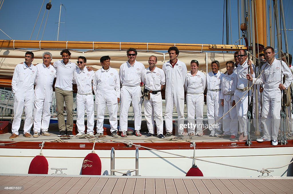 <a gi-track='captionPersonalityLinkClicked' href=/galleries/search?phrase=Rafael+Nadal&family=editorial&specificpeople=194996 ng-click='$event.stopPropagation()'>Rafael Nadal</a> of Spain with the crew at the Monaco Yacht Club before he sails a boat during day two of the ATP Monte Carlo Rolex Masters Tennis at Monte-Carlo Sporting Club on April 14, 2014 in Monte-Carlo, Monaco.