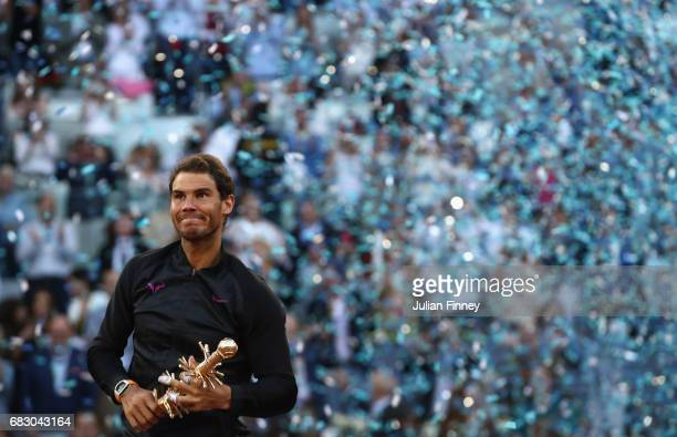 Rafael Nadal of Spain with the winners trophy after his win over Dominic Thiem of Austria in the final during day nine of the Mutua Madrid Open...