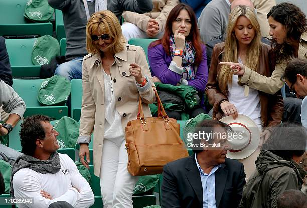 Rafael Nadal of Spain's girlfriend Xisca Perello sister Isabel Nadal and mother Ana Maria Parera are greeted by his uncle Miguel Nadal and father...