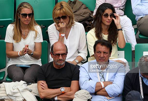 Rafael Nadal of Spain's mother Ana Maria Parera and girlfriend Xisca Perello sit behind his father Sebastian Nadal as they watch him during his men's...
