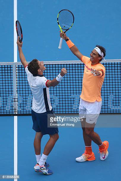 Rafael Nadal of Spian and Pablo Carreno Busta of Spain celebrate after winning the Mens's doubles final match against Jack Sock of the US and Bernard...