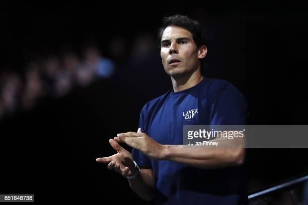 Rafael Nadal of Team Europe looks on as Denis Shapovalov of Team World plays his singles match against Alexander Zverev of Team Europe serevs on the...