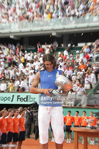 Rafael Nadal poses with the trophy after the final of the 2006 French Open at Roland Garros against Roger Federer Nadal won 16616476