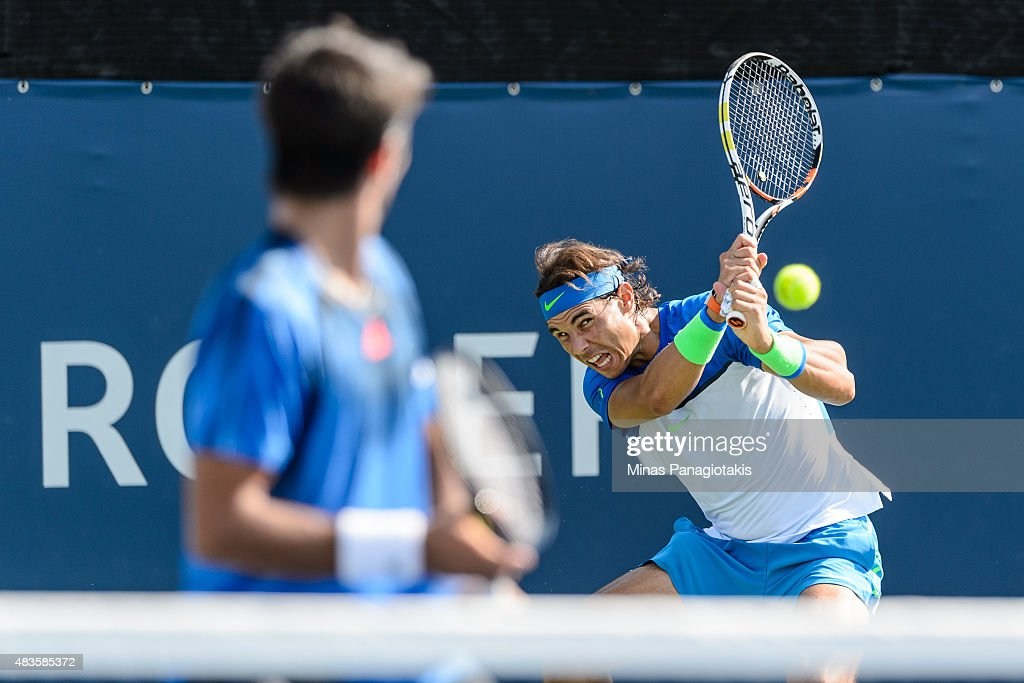 Rafael Nadal returns the ball in his doubles match against Tomas Berdych of the Czech Republic and Jack Sock of the USA during day one of the Rogers...