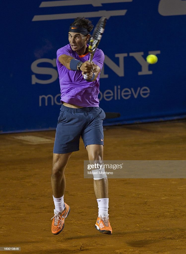 <a gi-track='captionPersonalityLinkClicked' href=/galleries/search?phrase=Rafael+Nadal&family=editorial&specificpeople=194996 ng-click='$event.stopPropagation()'>Rafael Nadal</a> returns the ball to David Ferrer during the final round match at the ATP Mexican Open Telcel on March 2, 2013 in Acapulco, Mexico.