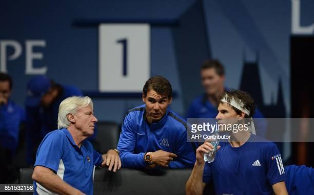 Rafael Nadal talks with Bjorn Borg Captain of Team Europe and Austrian Dominic Thiem during the match between Dominic Thiem and John Isner of United...