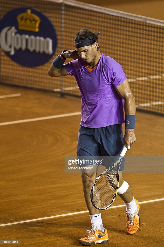 <a gi-track='captionPersonalityLinkClicked' href=/galleries/search?phrase=Rafael+Nadal&family=editorial&specificpeople=194996 ng-click='$event.stopPropagation()'>Rafael Nadal</a> walks during the final round match against David Ferrer at the ATP Mexican Open Telcel on March 2, 2013 in Acapulco, Mexico.
