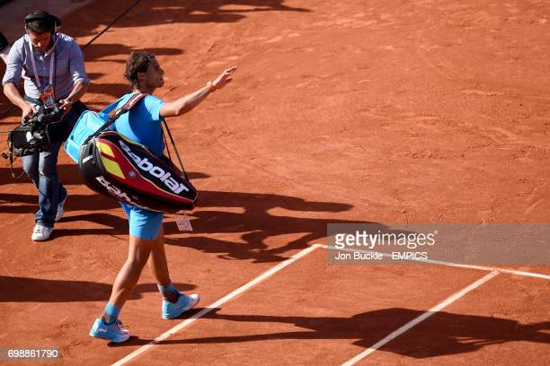 Rafael Nadal waves to the audience of the Men's Singles Quarterfinals on day eleven of the French Open at Roland Garros on June 3 2015 in Paris France