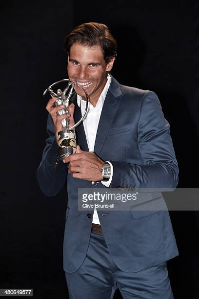 Rafael Nadal winner of the Laureus World Comeback of the Year award poses with their trophy announced at the 2014 Laureus World Sports Awards at the...