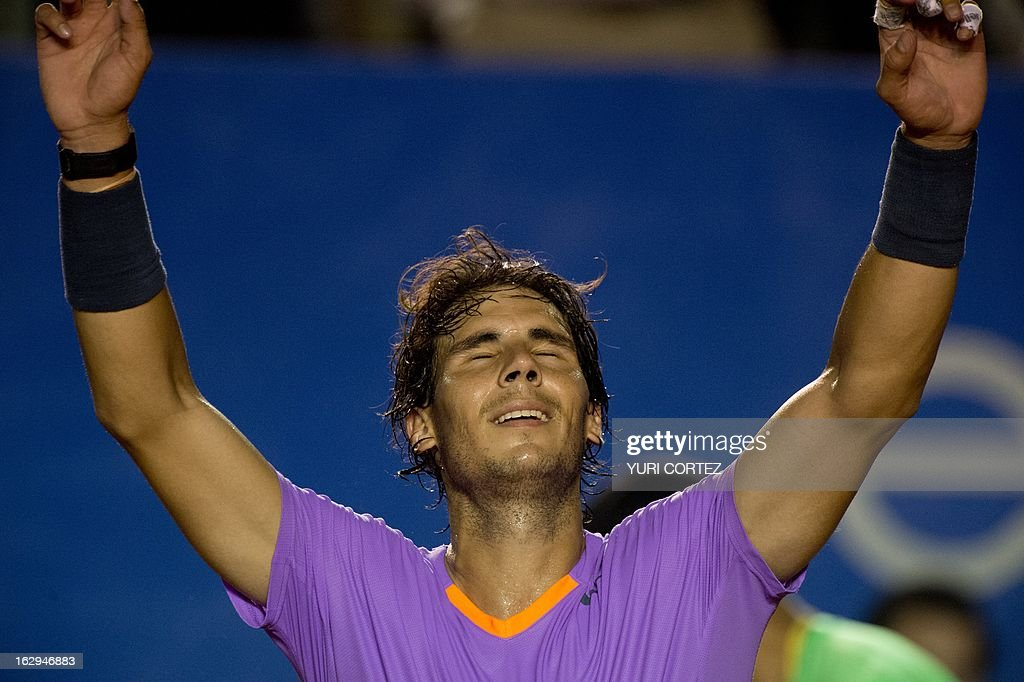 Rafael Nafal of Spain celebrates after defecting his compatriot Nicolas Almagro during their semi-final Mexico ATP Open men's single tennis match, in Acapulco, Guerrero state on March 1, 2013. AFP PHOTO/ Yuri CORTEZ