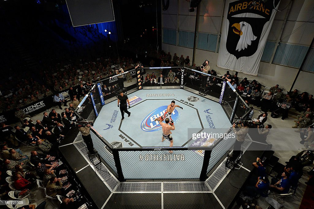 Rafael Natal kicks Tim Kennedy in their UFC middleweight bout on November 6, 2013 in Fort Campbell, Kentucky.