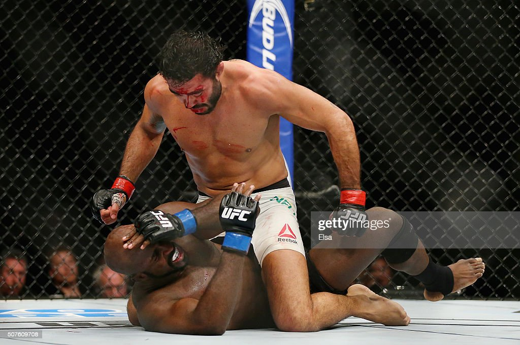 Rafael Natal of Brazil punches Kevin Casey of the United States in their middleweight bout during the UFC Fight Night event at the Prudential Center on January 30, 2016 in Newark, New Jersey. Natal won by TKO.