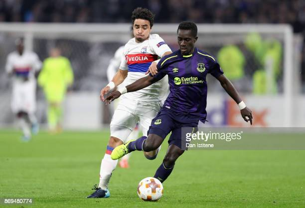 Rafael of Lyon and Idrissa Gueye of Everton battle for possession during the UEFA Europa League group E match between Olympique Lyon and Everton FC...