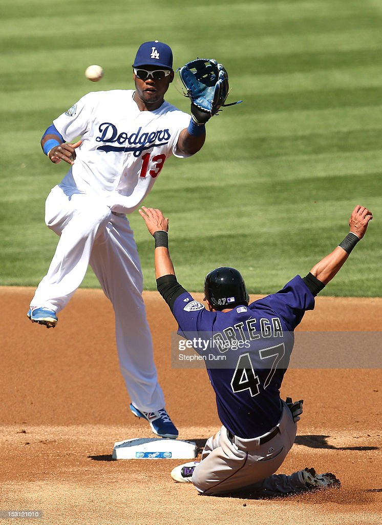 Rafael Ortega #47 of the Colorado Rockies slides into second with a stolen base ahead of the throw to shortstop <a gi-track='captionPersonalityLinkClicked' href=/galleries/search?phrase=Hanley+Ramirez&family=editorial&specificpeople=538406 ng-click='$event.stopPropagation()'>Hanley Ramirez</a> #13 of the Los Angeles Dodgers in the first inning on September 30, 2012 at Dodger Stadium in Los Angeles, California.