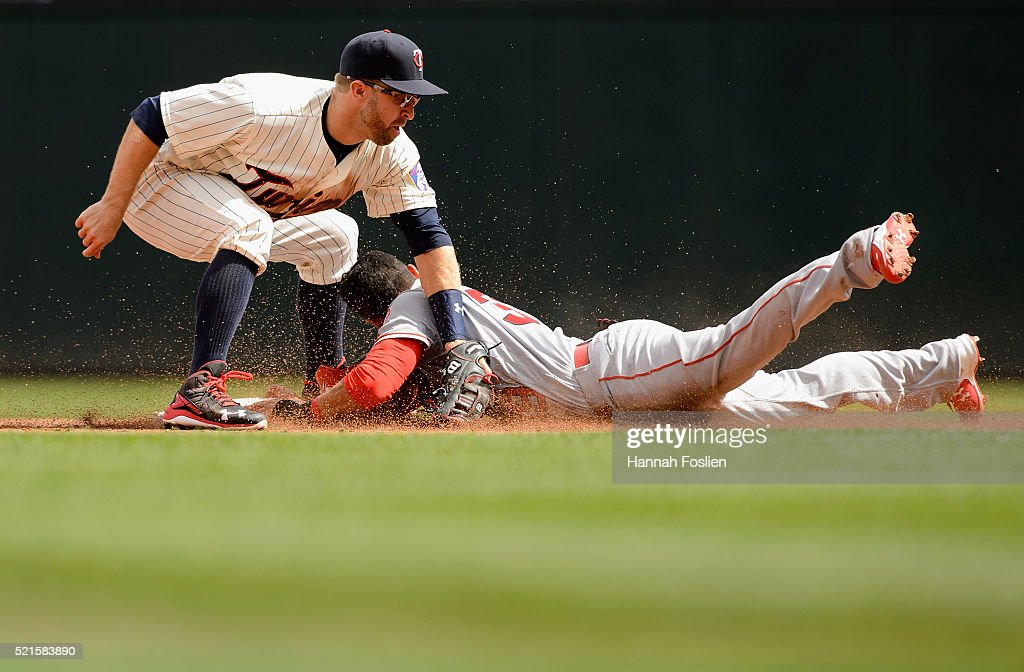 Rafael Ortega of the Los Angeles Angels of Anaheim steals second base against Brian Dozier of the Minnesota Twins during the second inning of the...