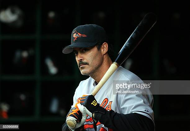 Rafael Palmeiro of the Baltimore Orioles looks on from the dugout during an MLB game against the Oakland Athletics at McAfee Coliseum on August 16...