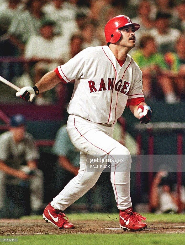 Rafael Palmeiro of the Texas Rangers watches his t : News Photo